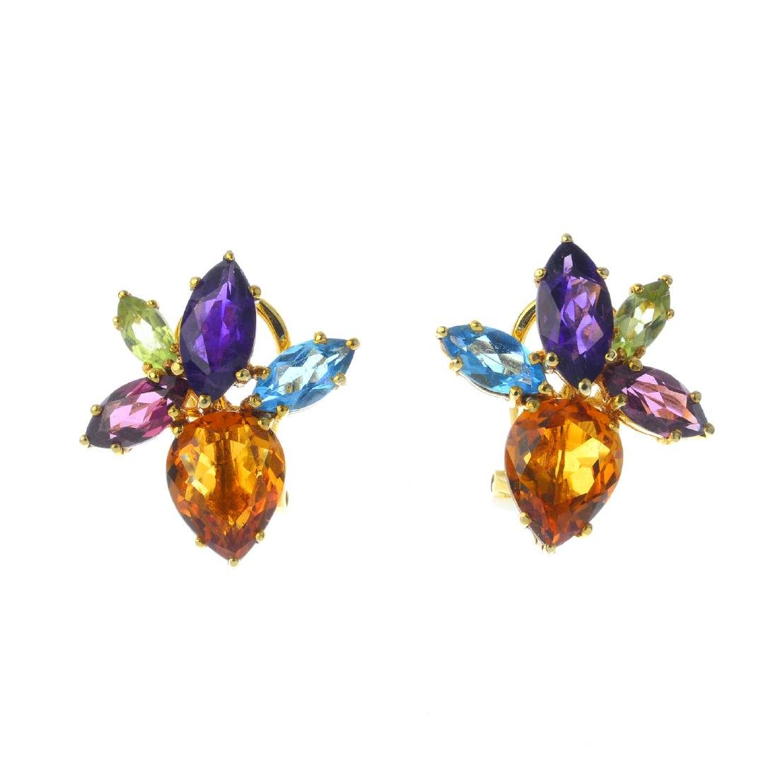 A pair of gem-set earrings. Each design as a vari-gem