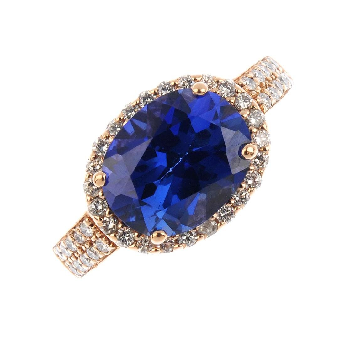 A synthetic sapphire and diamond ring. The oval-shape