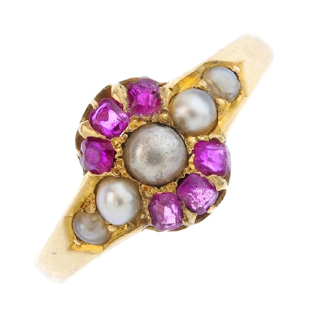 An 18ct gold gem-set ring. Designed as a graduated