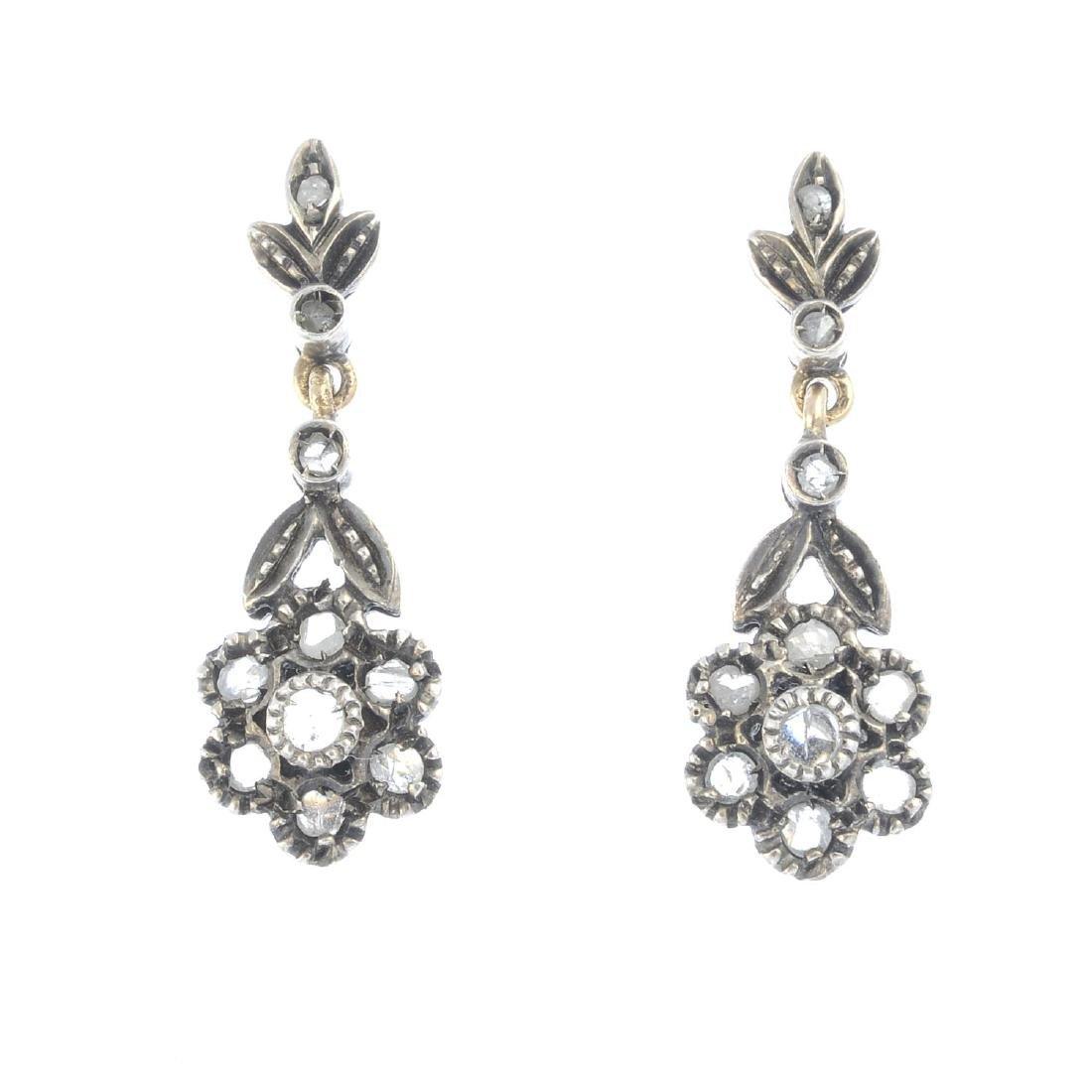 A pair of diamond earrings. Each designed as a rose-cut