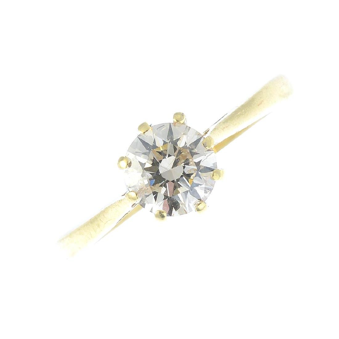 An 18ct gold diamond single-stone ring. The