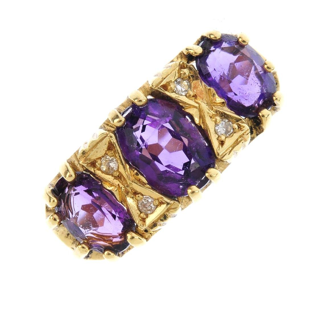 An 18ct gold amethyst and diamond dress ring. The