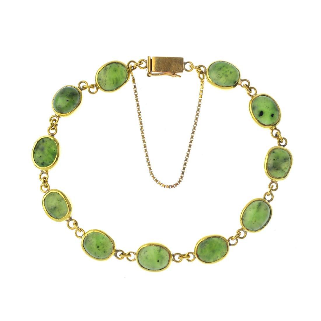 A jade bracelet. Designed as a series of oval nephrite