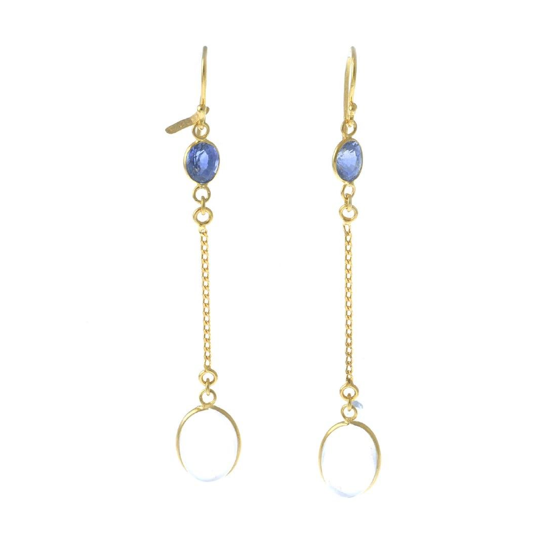 A pair of moonstone and sapphire earrings. Each