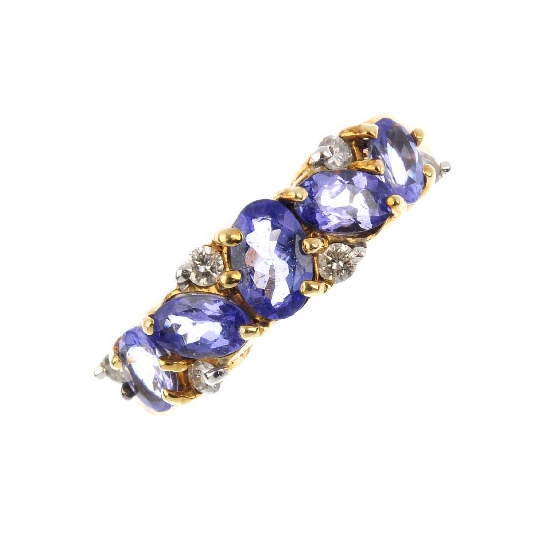 A tanzanite and diamond dress ring. The graduated