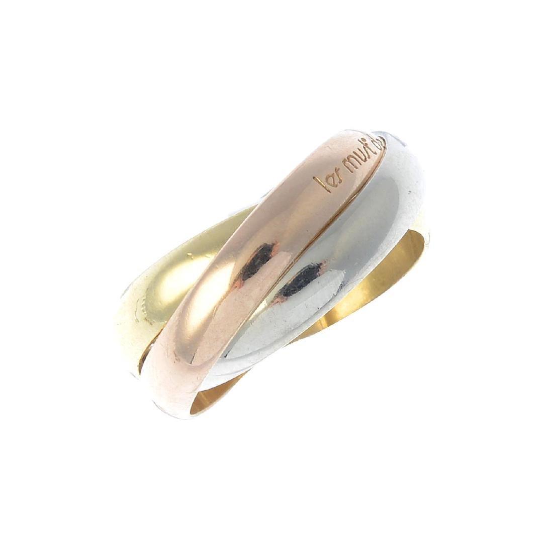 CARTIER - a 'Trinity' ring. Of tri-colour design,