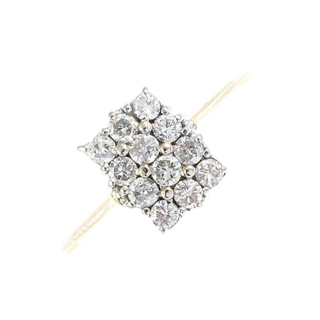 A gold diamond cluster ring. Designed as a