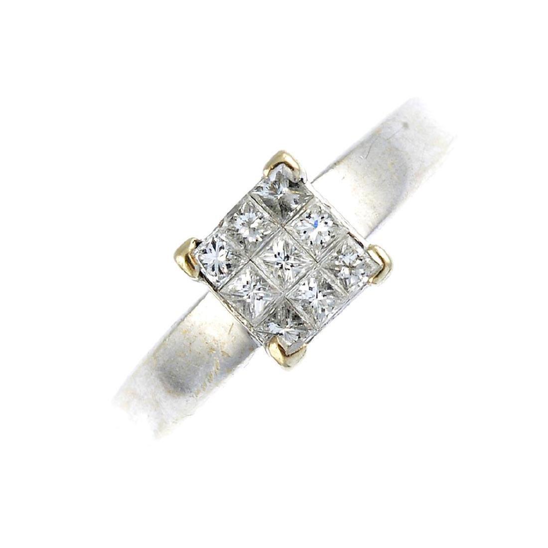 An 18ct gold diamond ring. The square-shape diamond