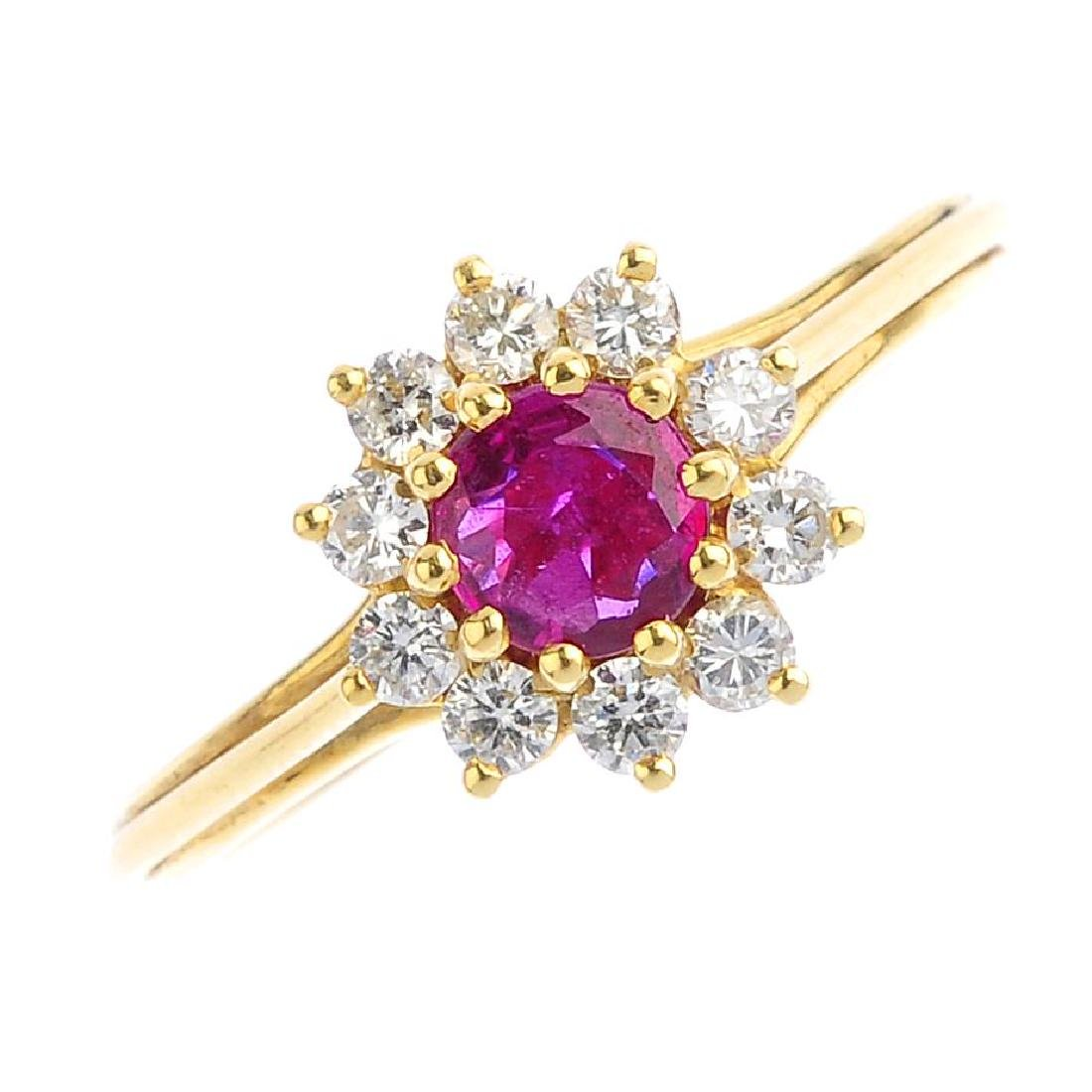 A ruby and diamond cluster ring. The circular-shape