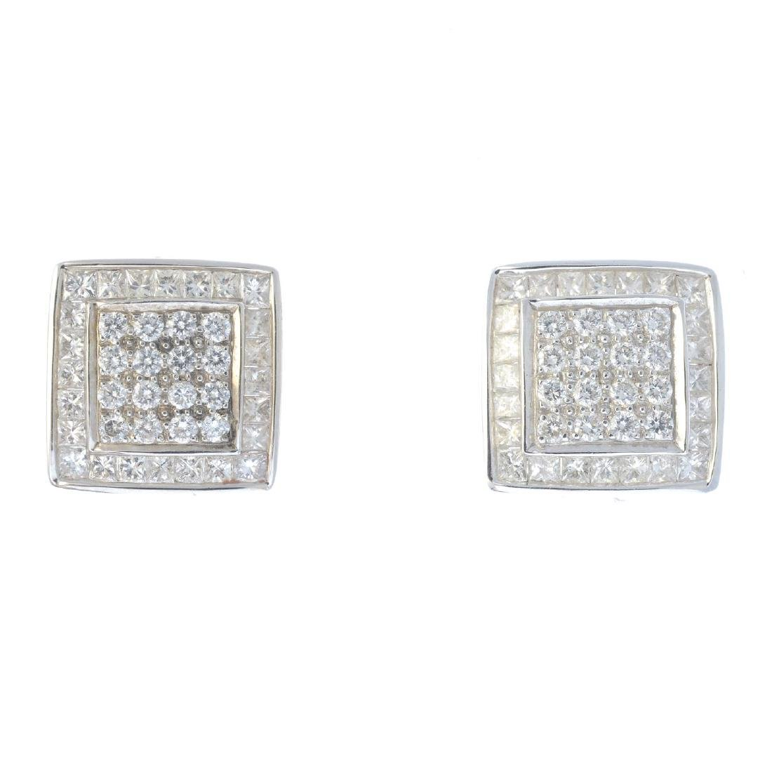 A pair of diamond cluster earrings. Designed as a