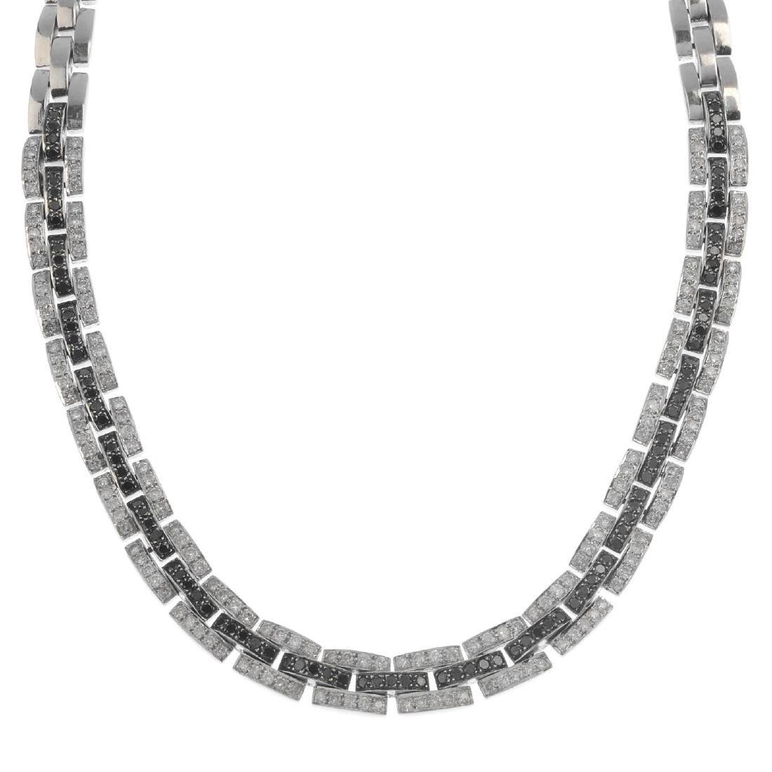 A diamond and gem-set necklace. Designed as a