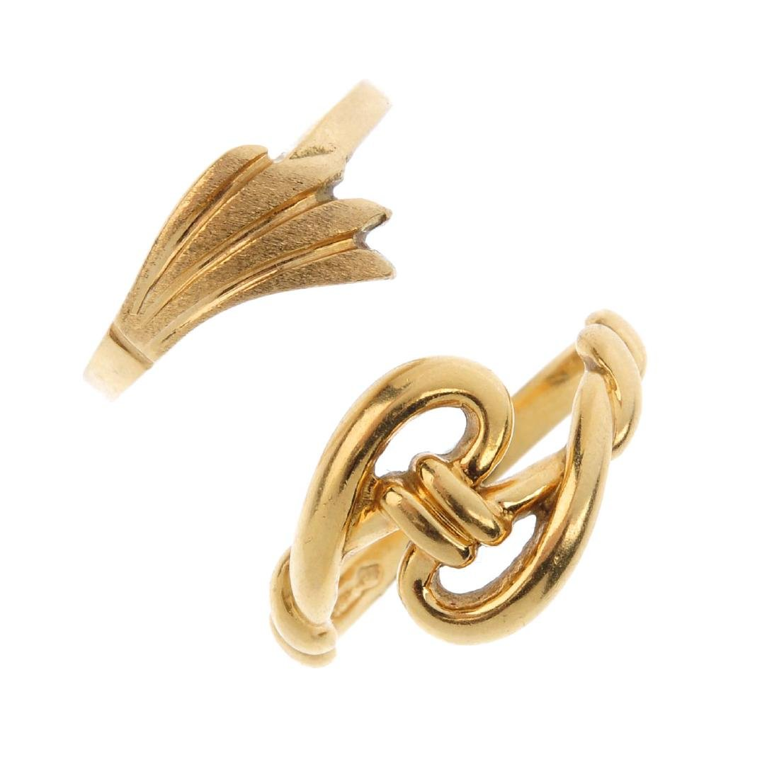 Two rings. The first designed as a stylised knot ring,