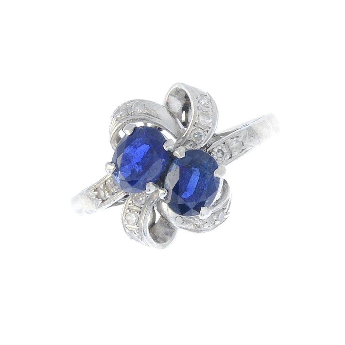 A sapphire and diamond dress ring. Designed as an