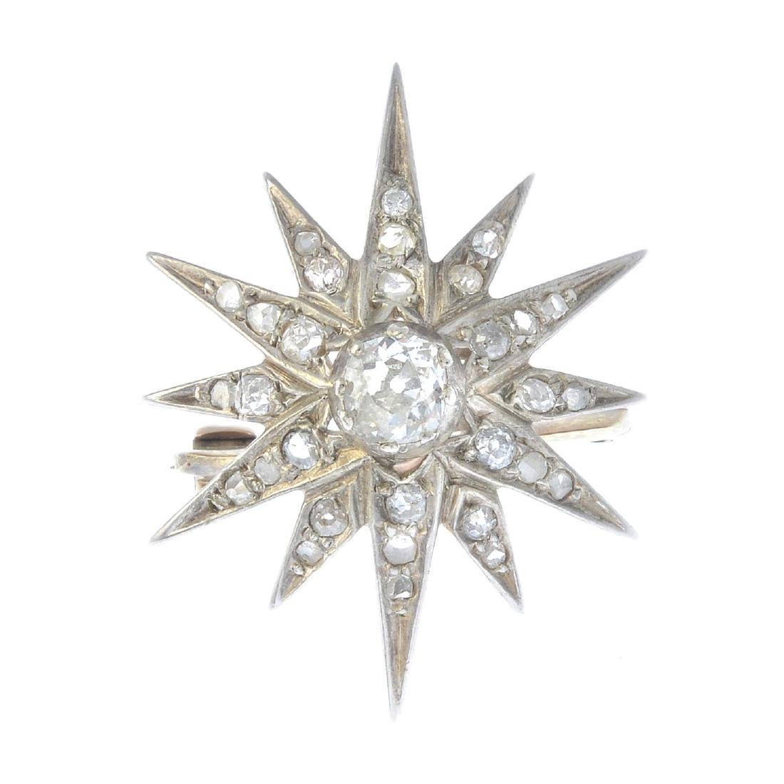 A late Victorian gold diamond star brooch. The central
