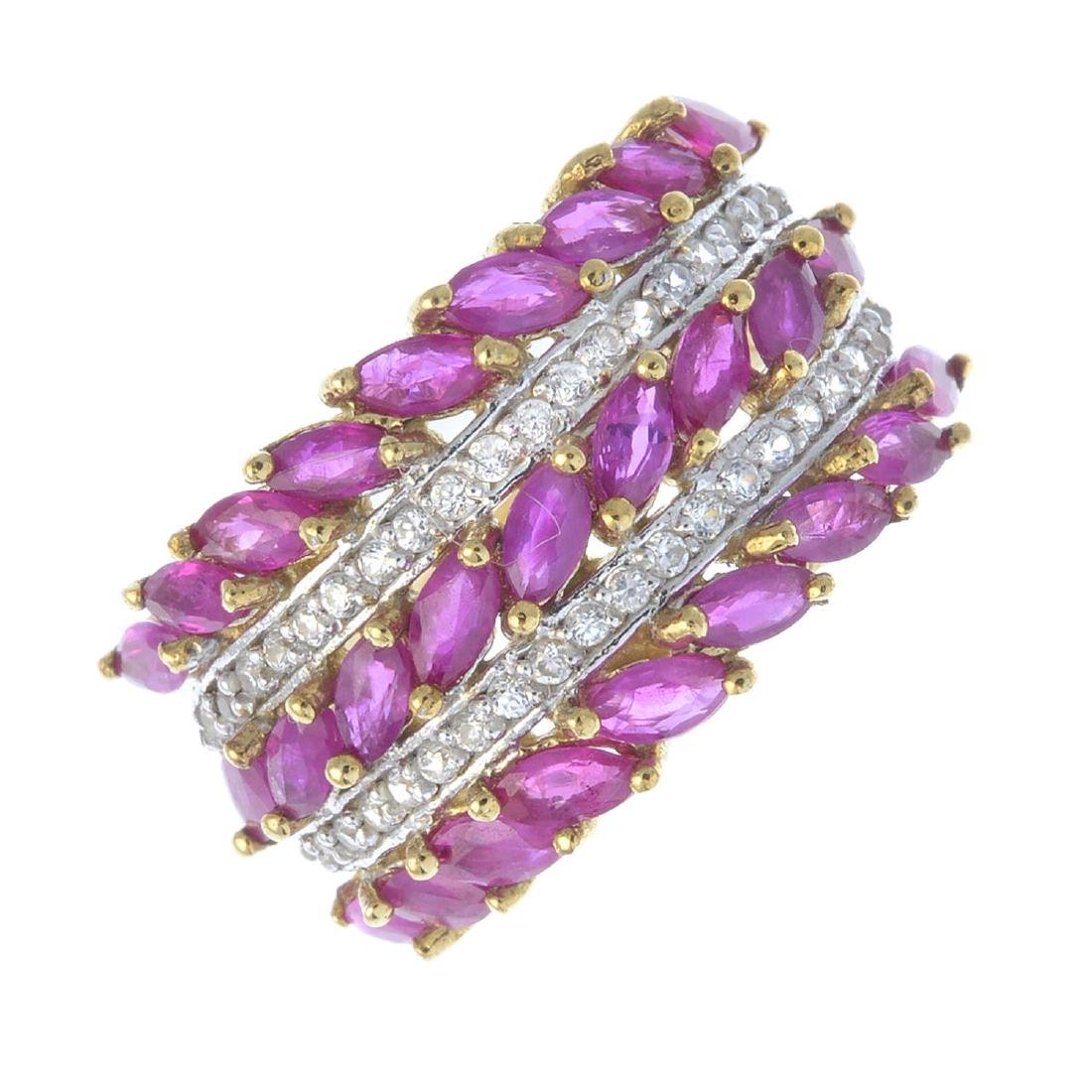 A 9ct gold ruby and cubic zirconia dress ring. Designed