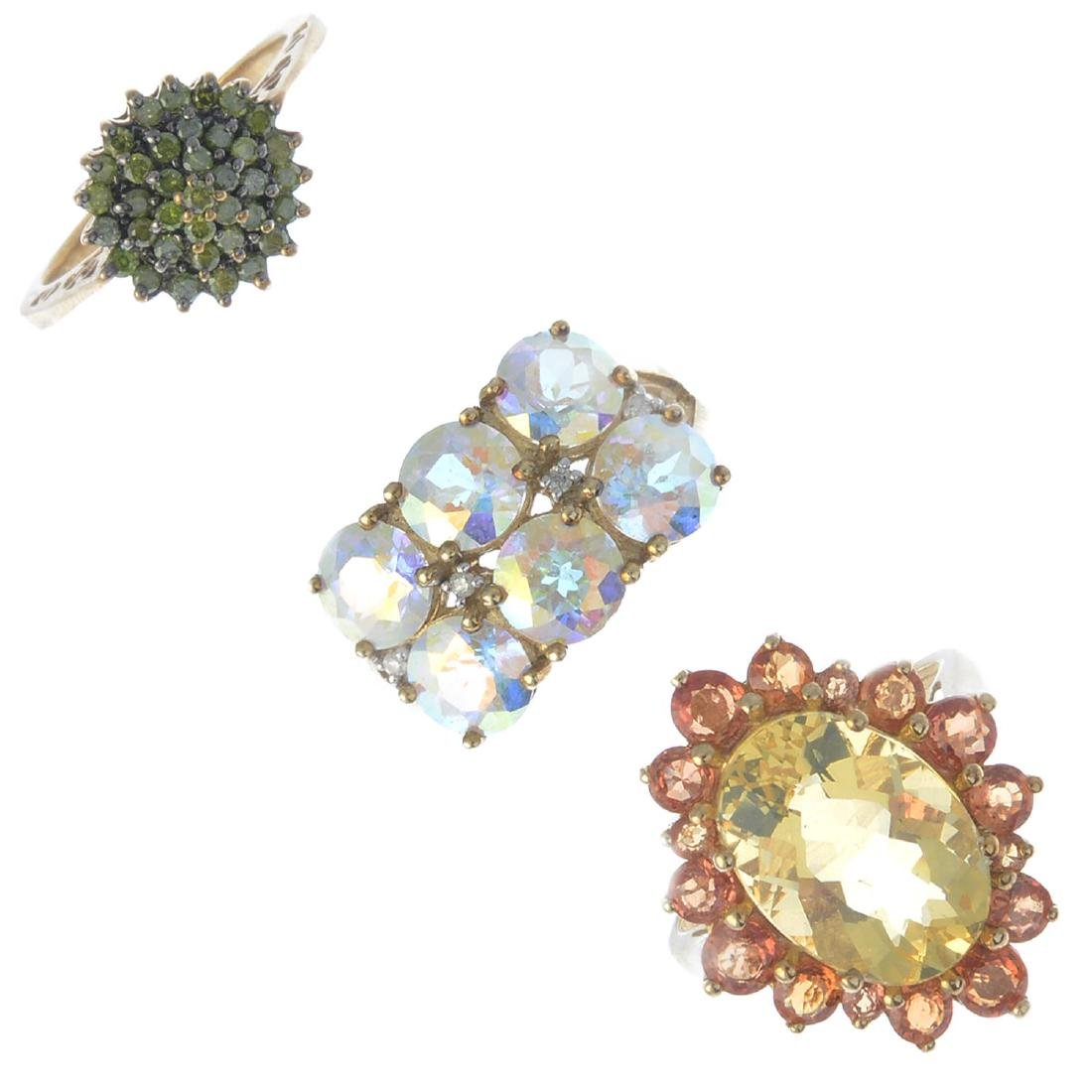 Three 9ct gold gem-set dress rings. To include a fire