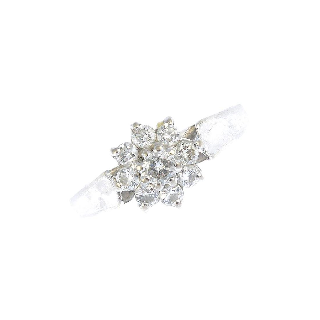 A diamond floral cluster ring. The brilliant-cut