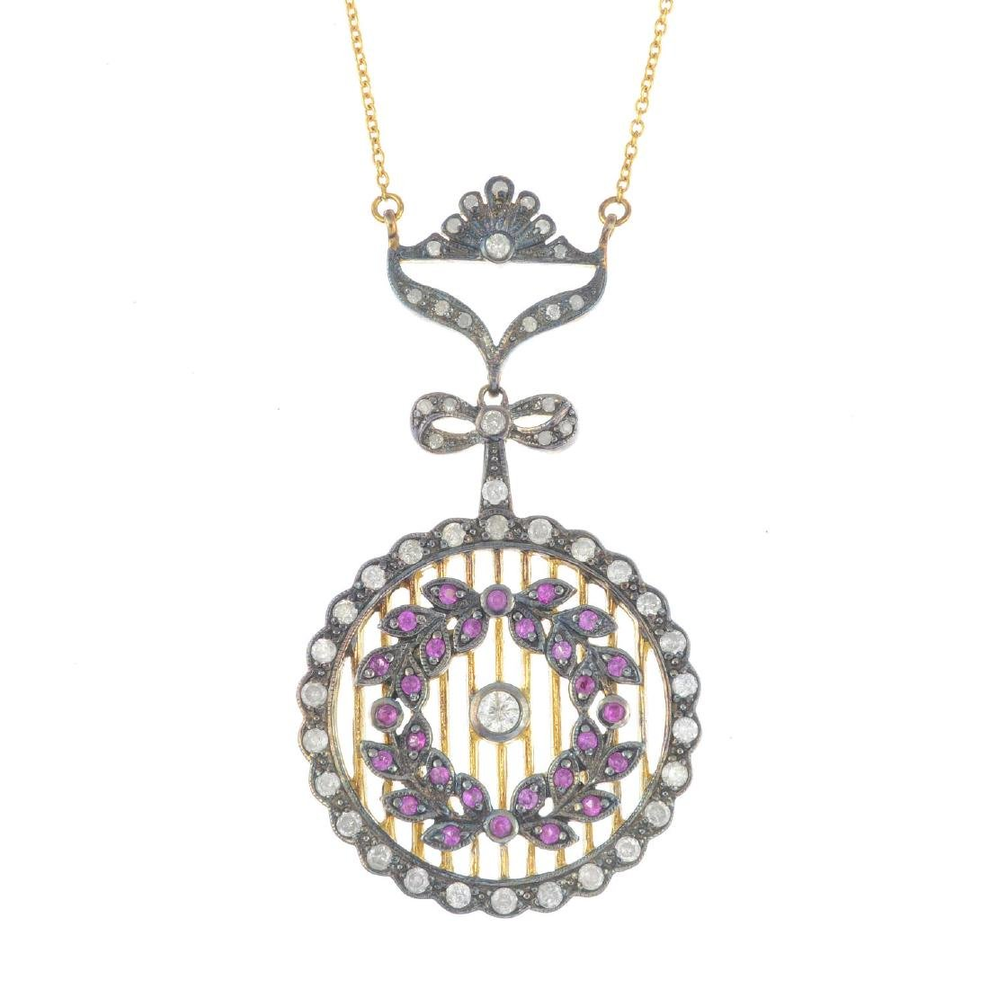 A diamond and ruby pendant. Of openwork design, the