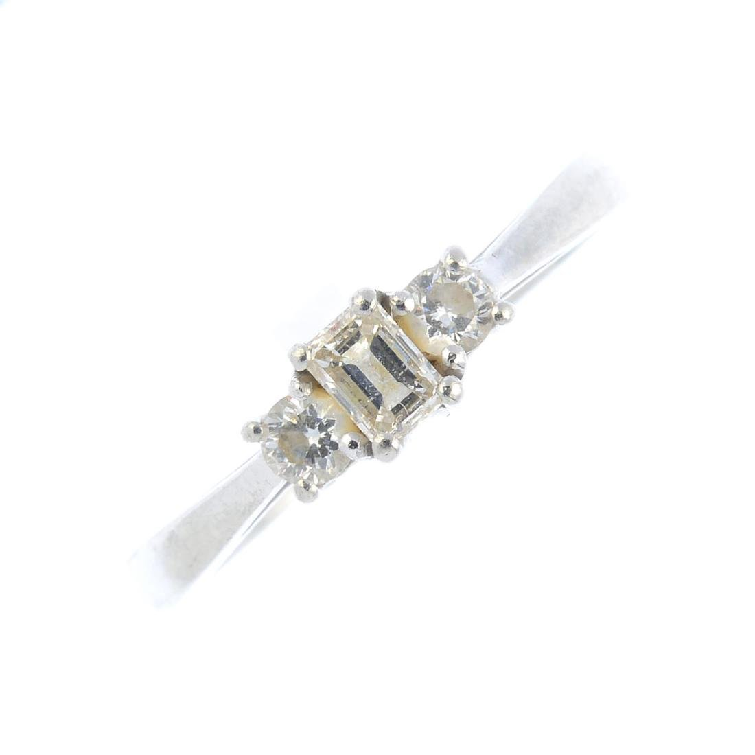 A platinum diamond three-stone ring. The