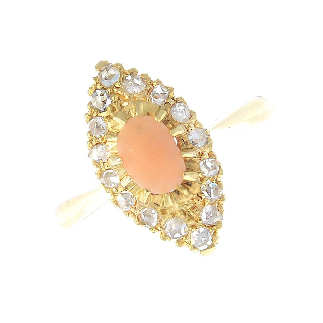 A coral and diamond dress ring. The oval coral