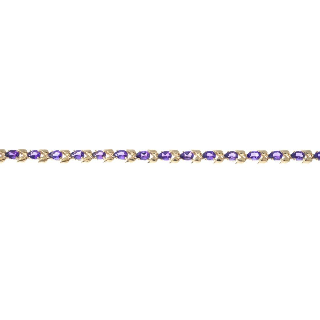 A 9ct gold amethyst bracelet. Designed as a series of