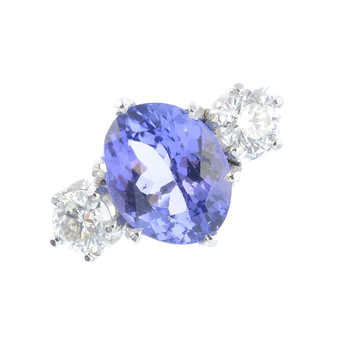 A tanzanite and diamond three-stone ring. The