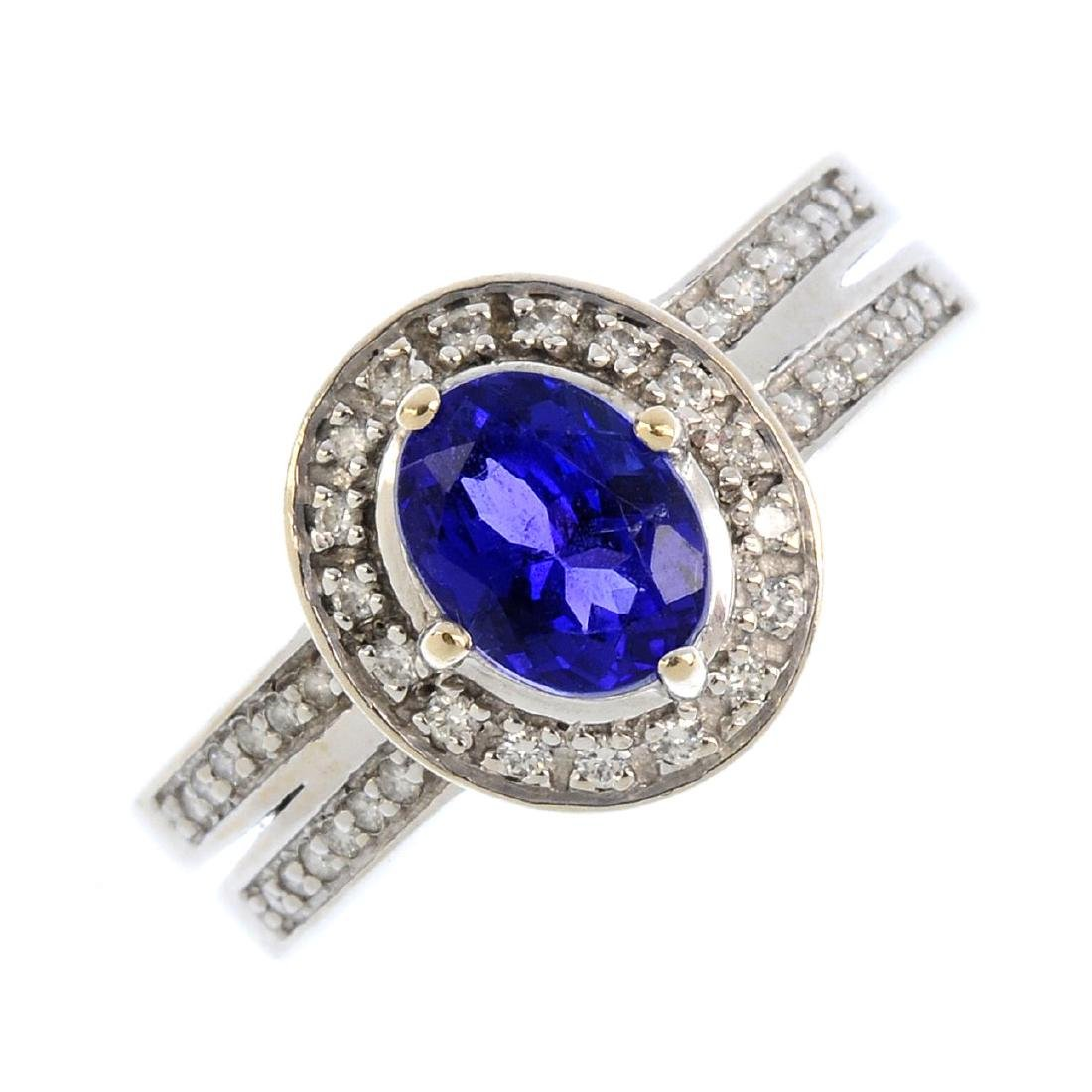 A tanzanite and diamond cluster ring. The oval-shape