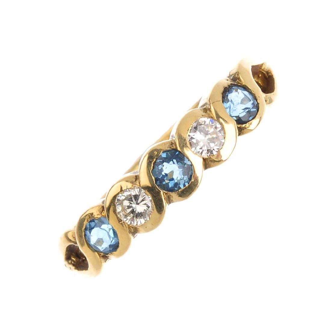 An 18ct gold synthetic spinel and diamond half eternity