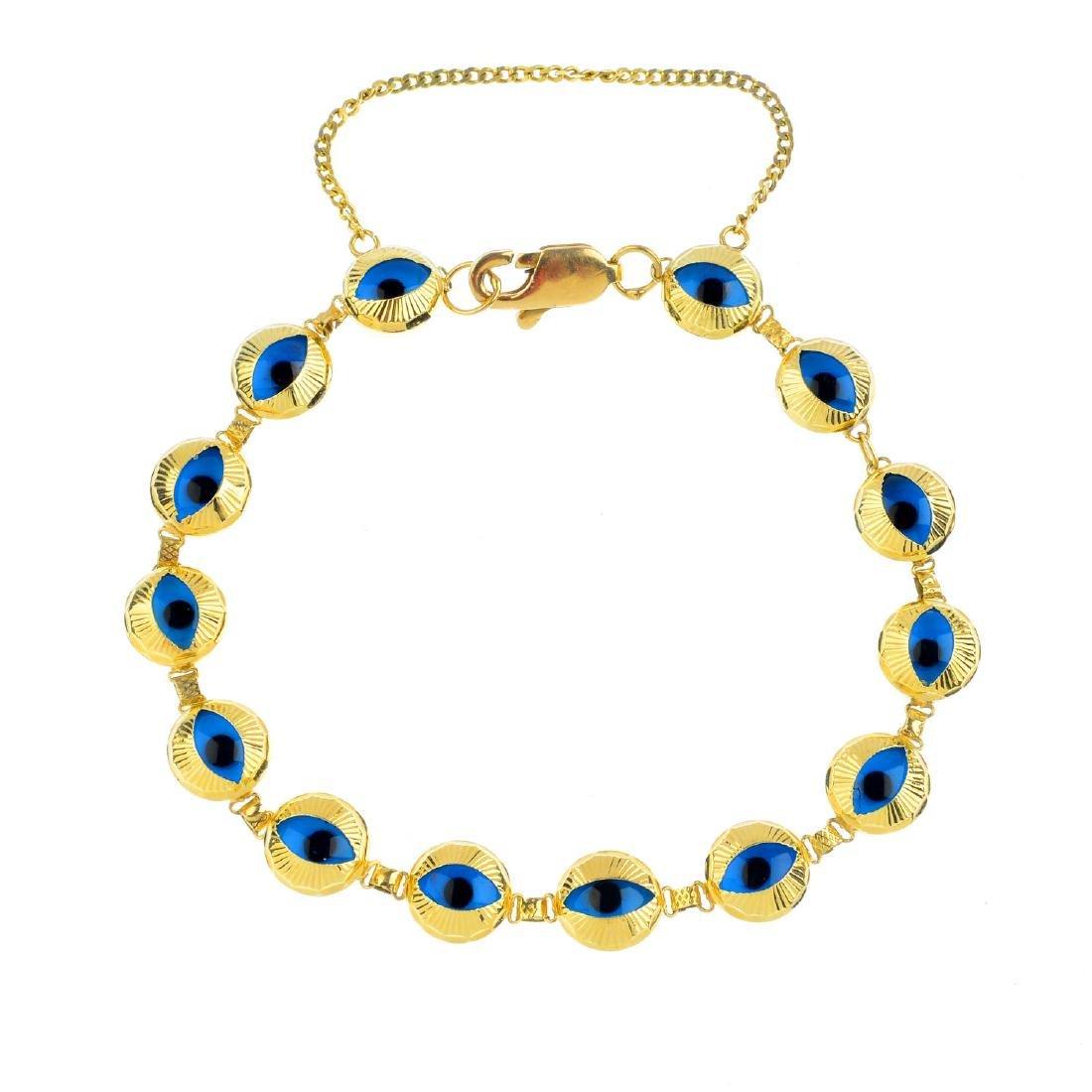 A bracelet. Designed as a series of circular glass