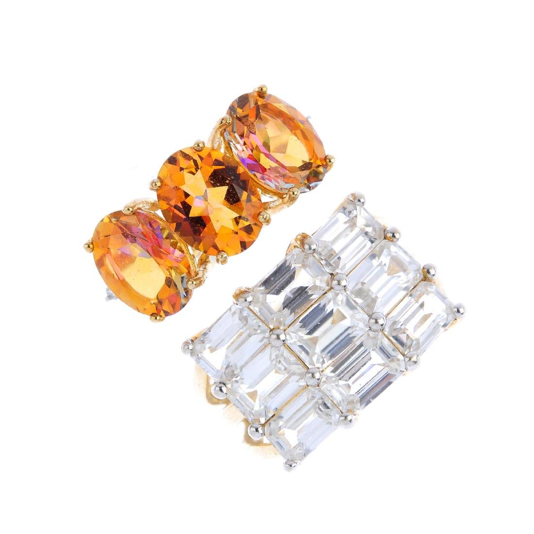 Two 9ct gold gem-set dress rings. The first, an