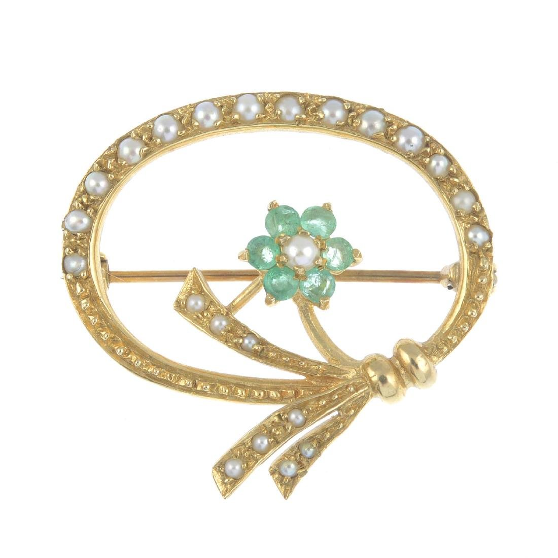 A 9ct gold emerald and split pearl brooch. Of openwork
