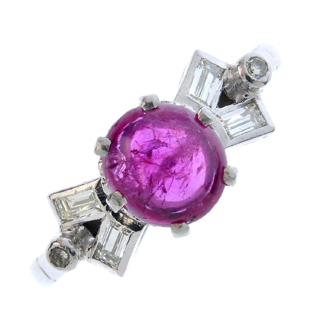 A ruby and diamond ring.  The circular-shape ruby
