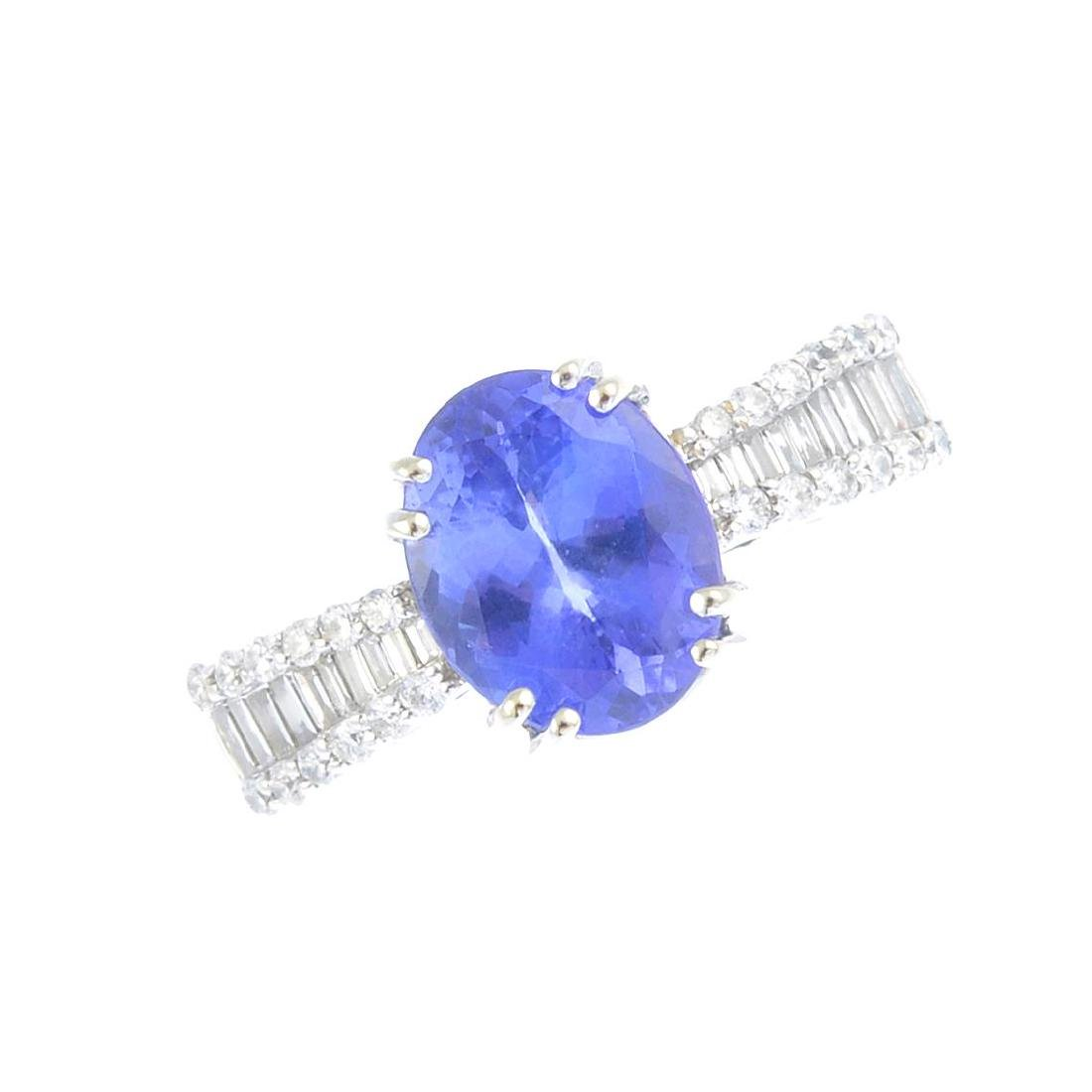 A tanzanite and diamond dress ring. Designed as an