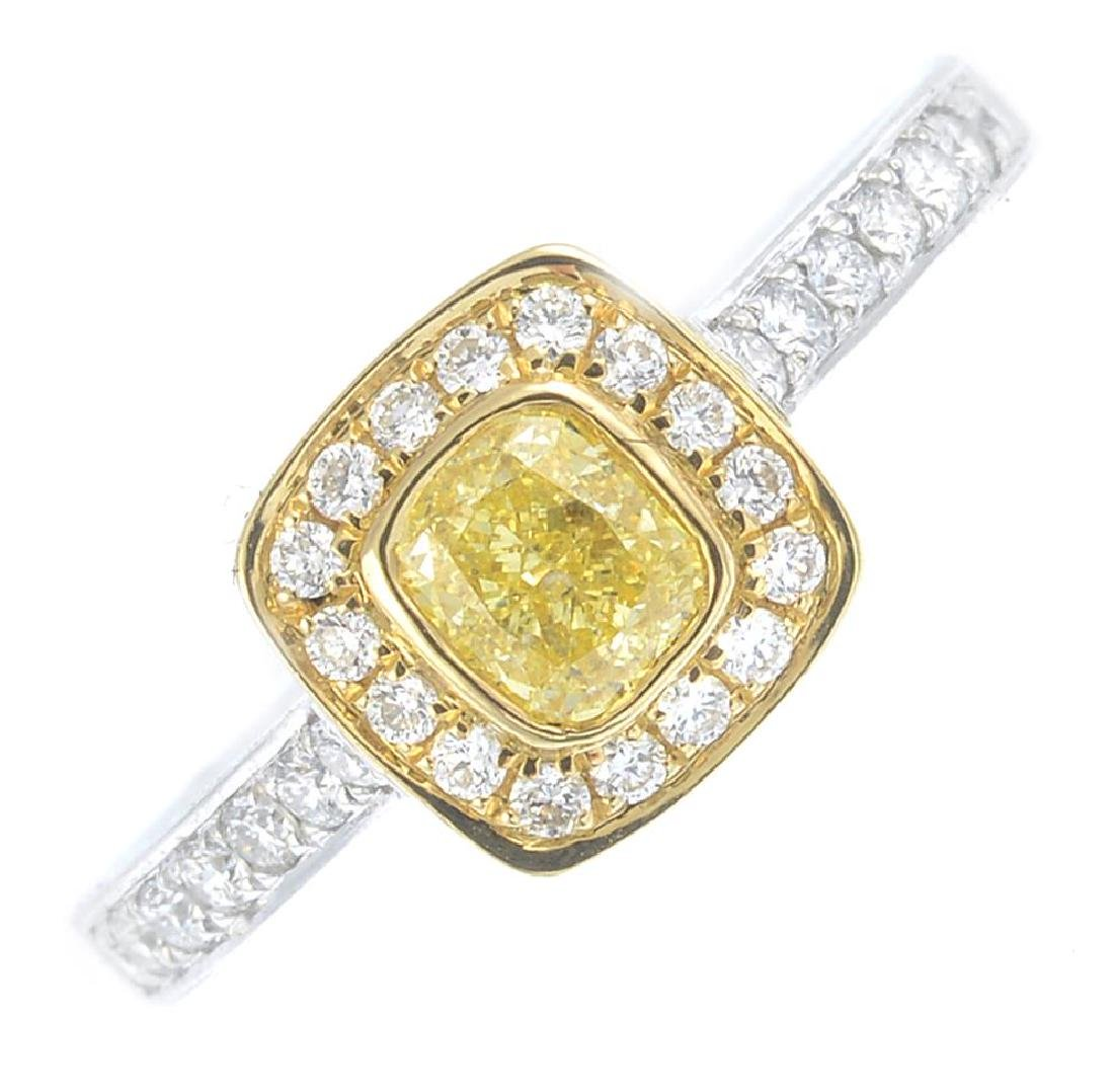 A 'coloured' diamond and diamond cluster ring. Of