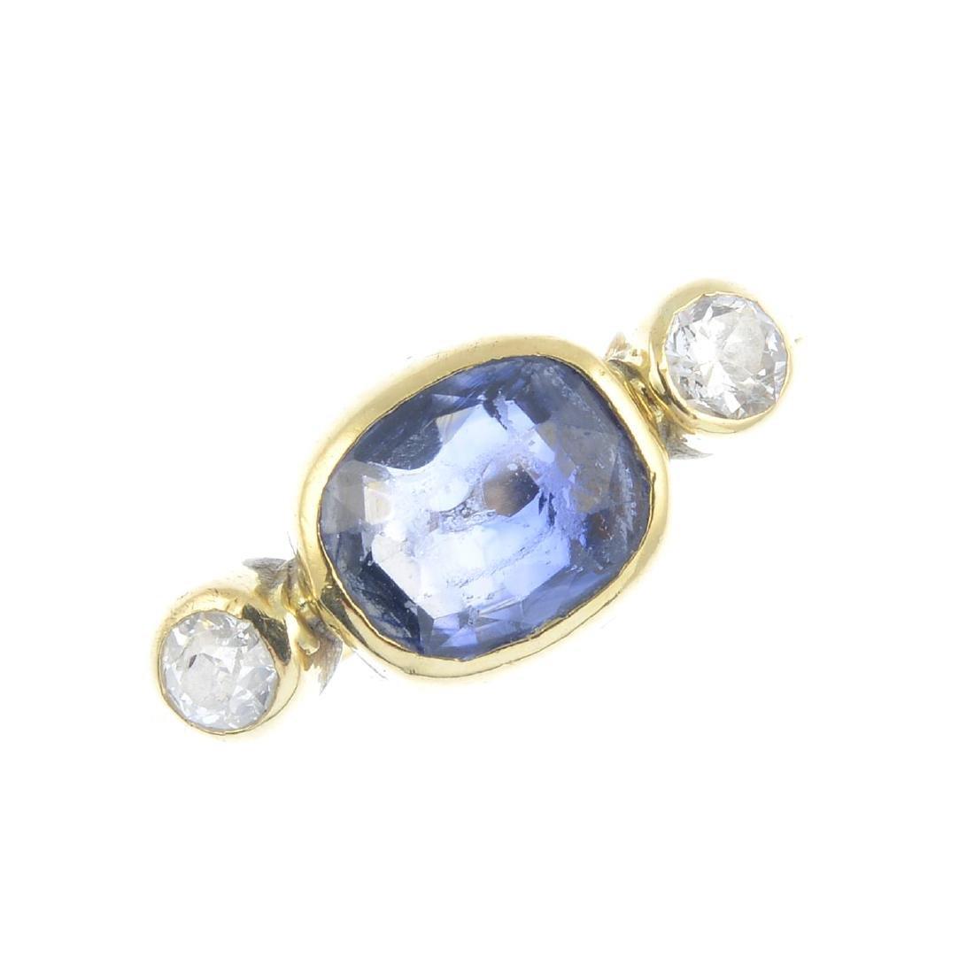 A sapphire and diamond ring. The cushion-shape sapphire