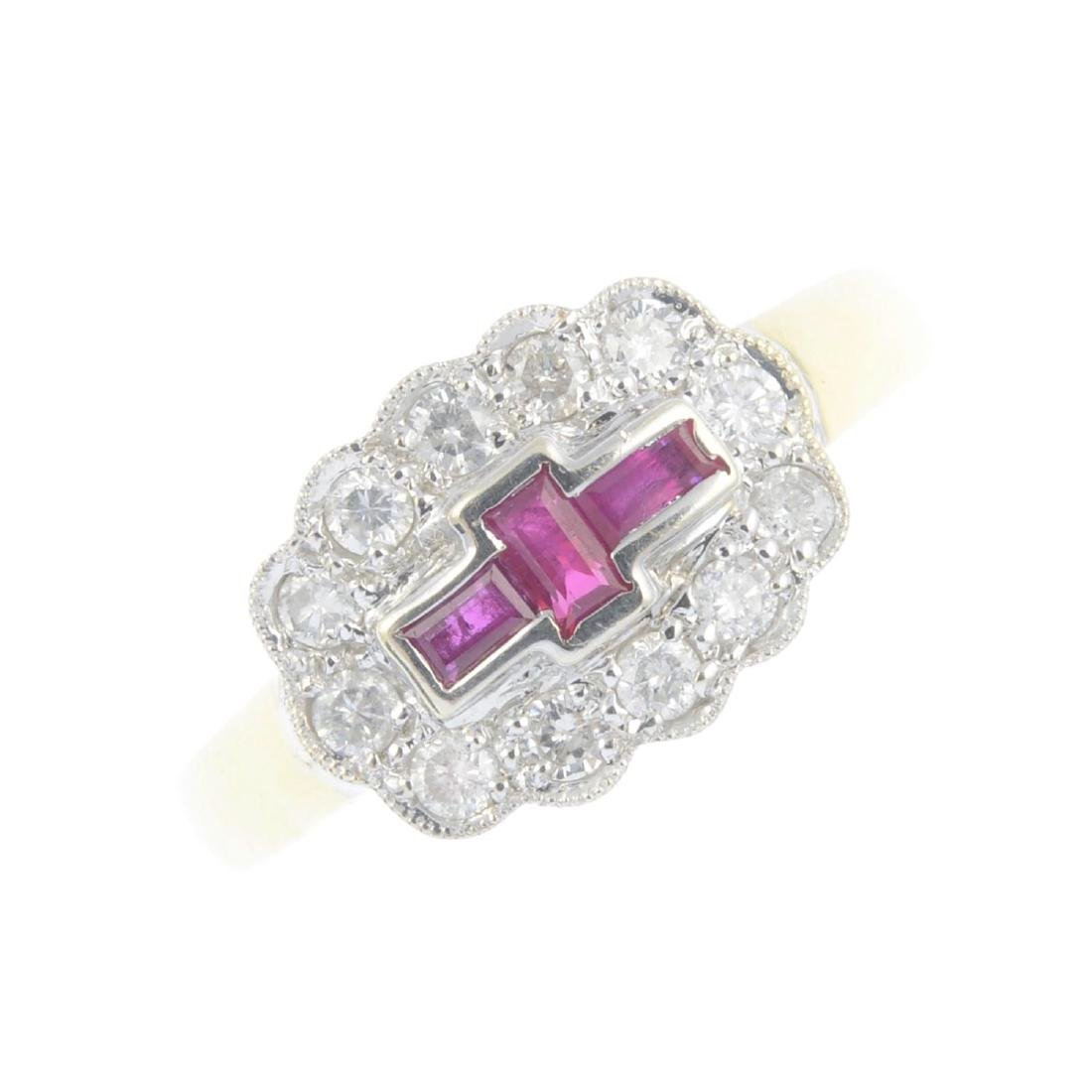 An 18ct gold ruby and diamond dress ring. Designed as a
