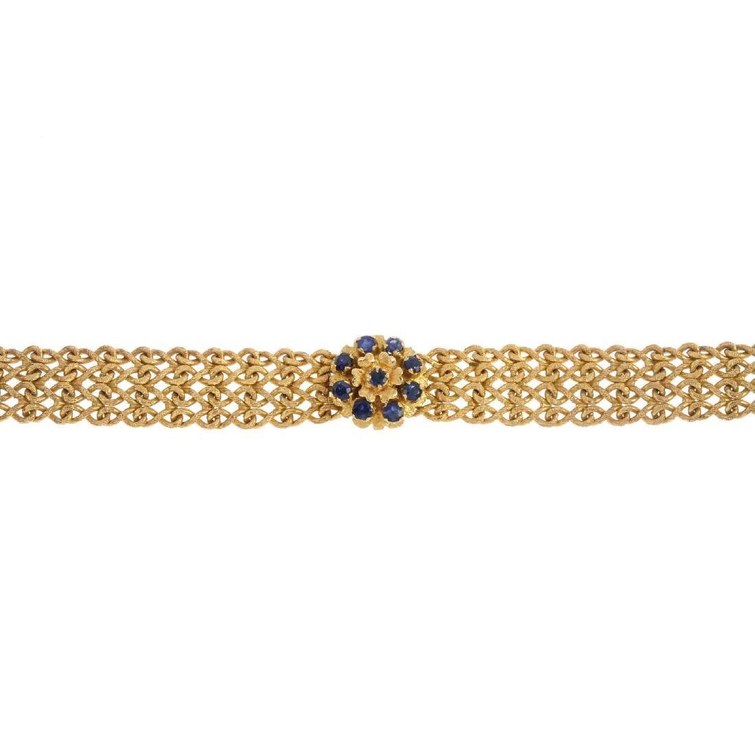 A sapphire bracelet. The circular-shape sapphire accent