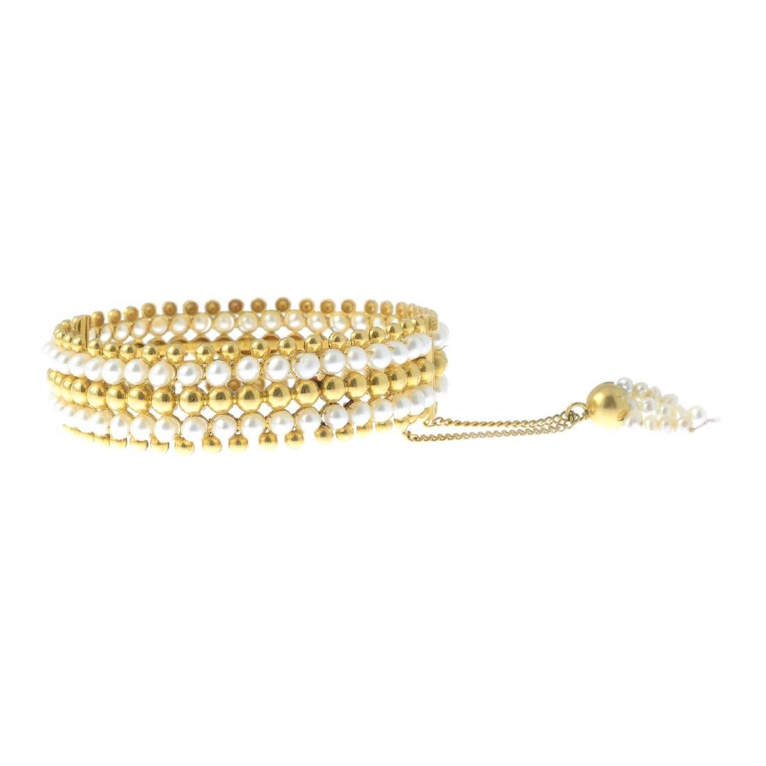 A cultured pearl bangle. Comprising alternating