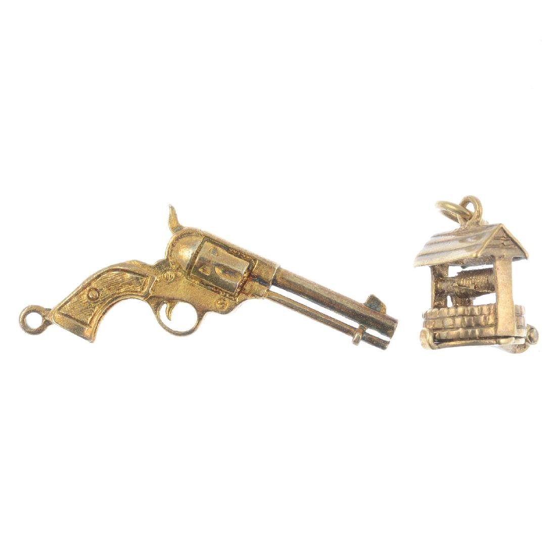 Two charms. To include a 9ct gold wishing well charm,