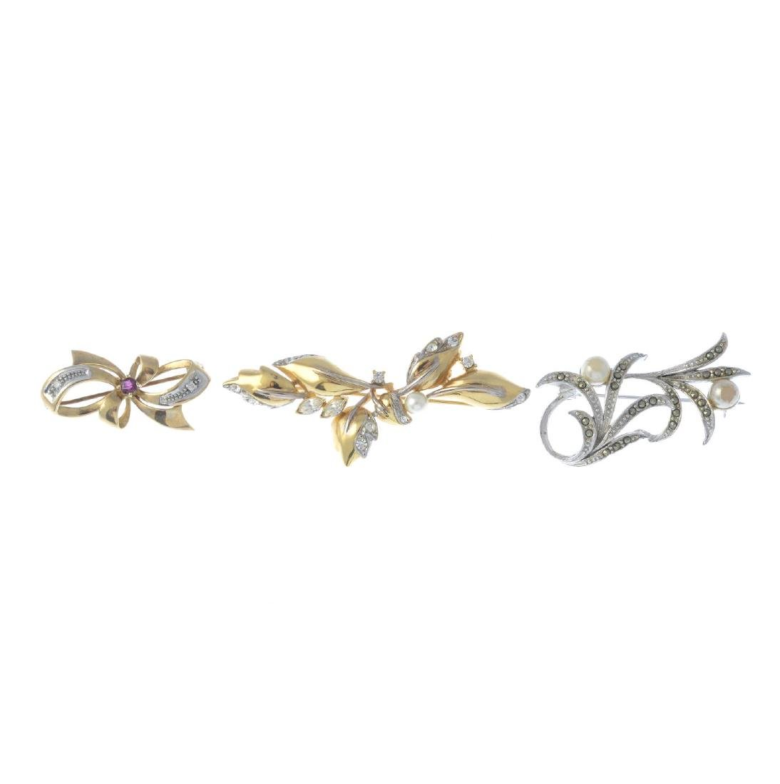 Three gem-set brooches. To include a 9ct gold ruby and