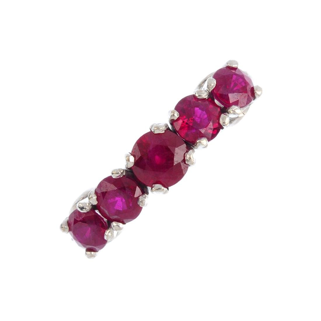 A synthetic ruby five-stone ring. The graduated