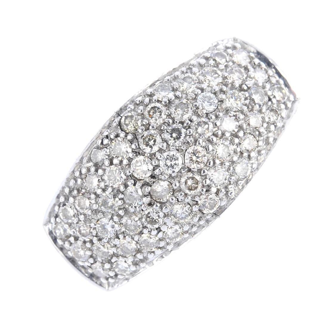 A 9ct gold diamond dress ring. The pave-set diamond