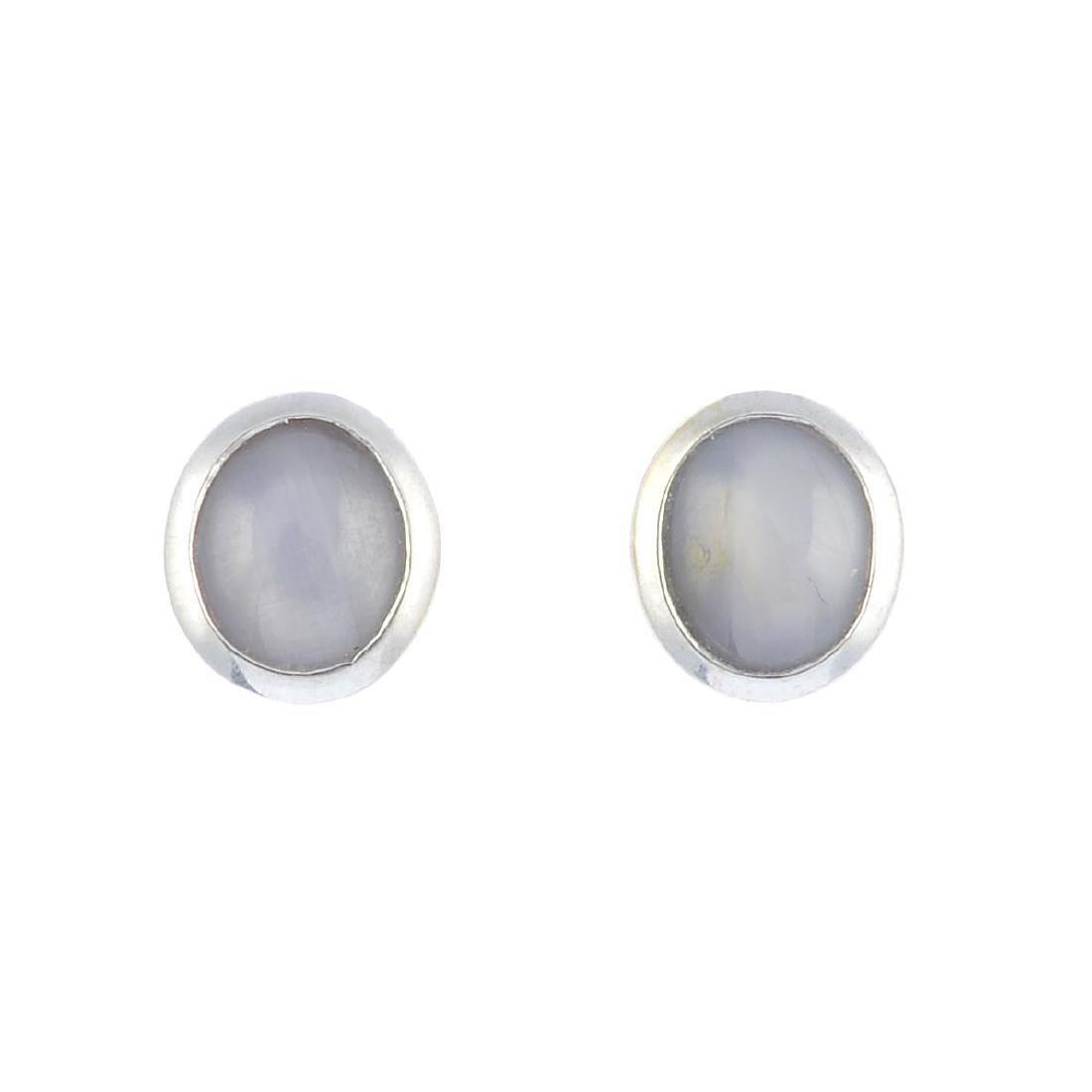 A pair of star sapphire stud earrings. Each designed as