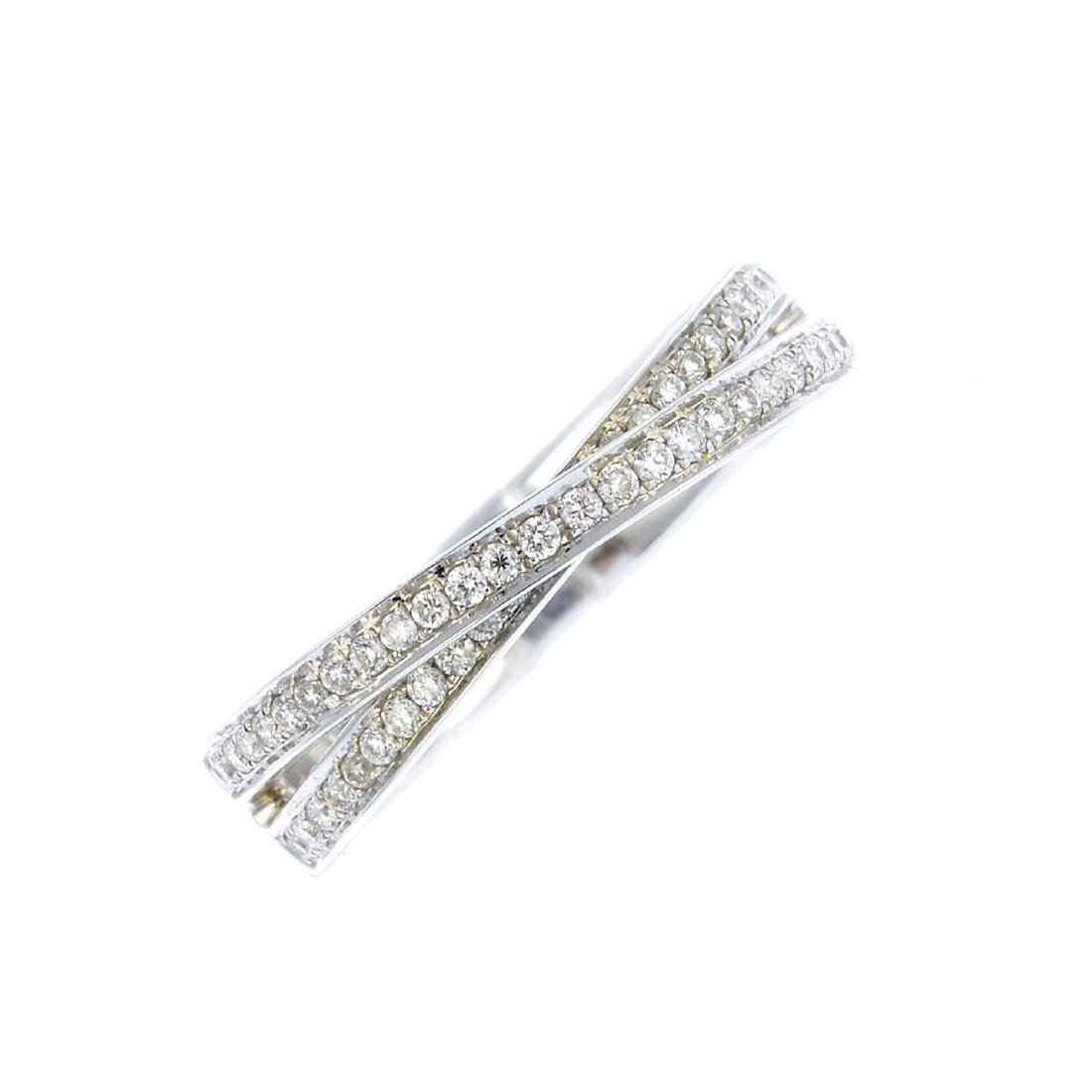 An 18ct gold diamond dress ring. Designed as two