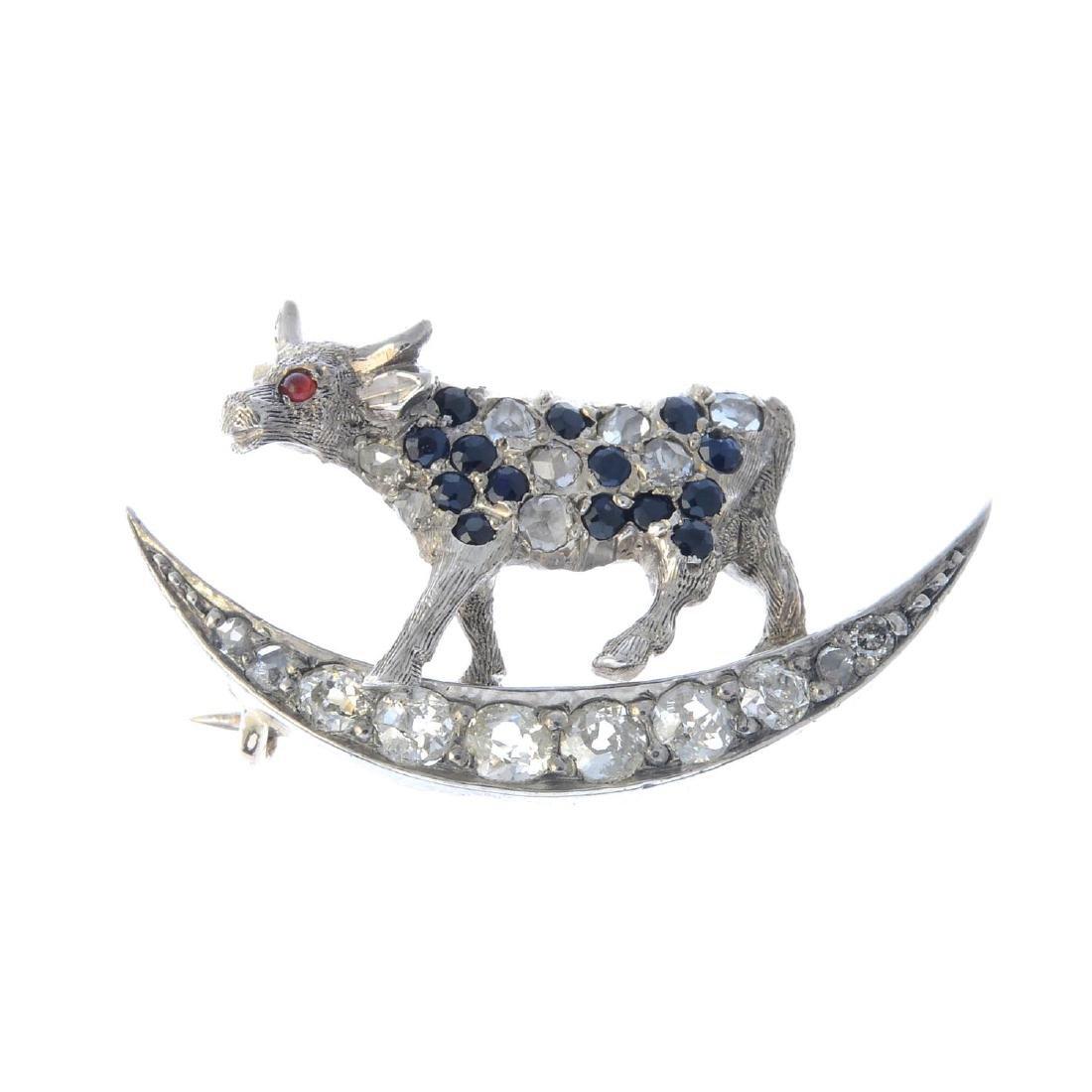 A diamond and gem-set cow and moon nursery rhyme