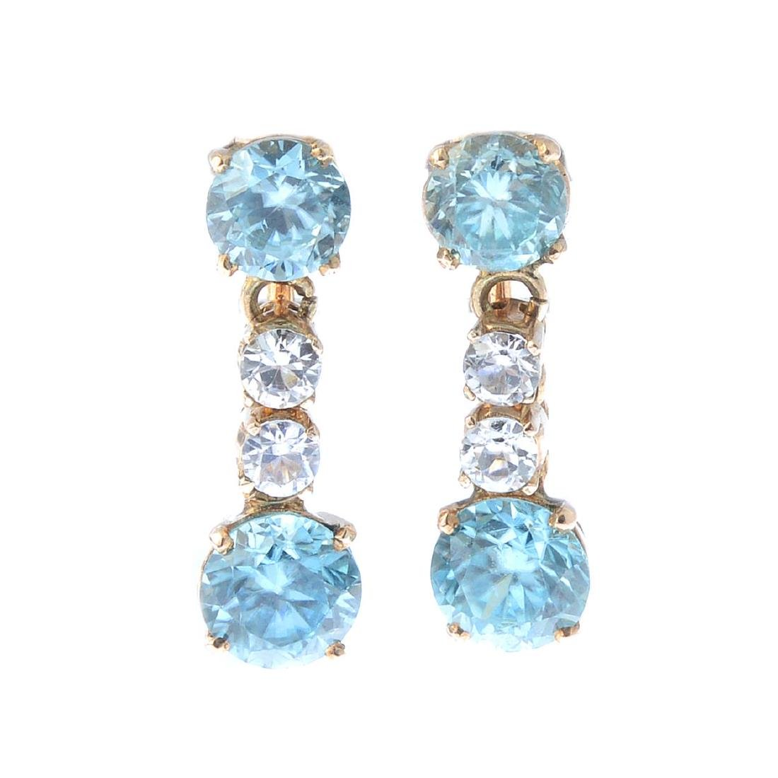 A pair of zircon and rock crystal earrings. Each