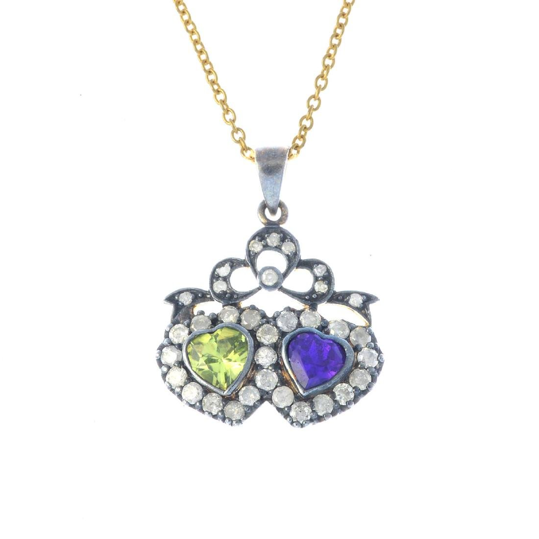 A diamond, amethyst and peridot pendant. The