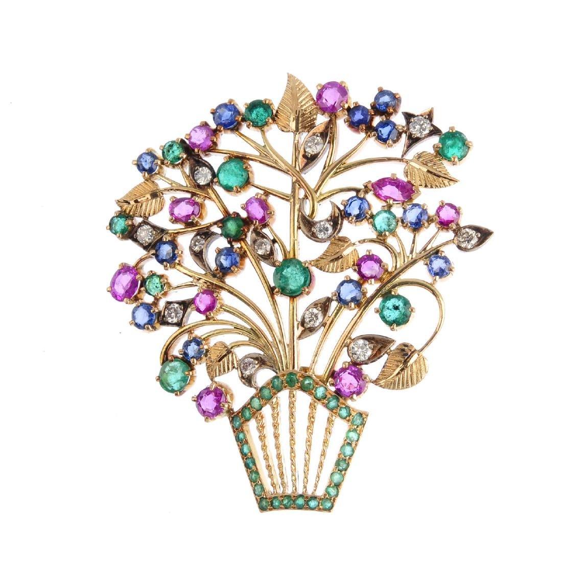 A diamond and gem-set basket pendant. Designed as a