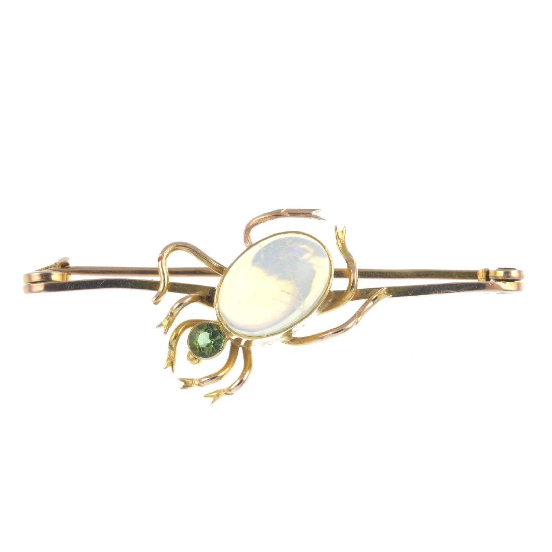A gem-set spider brooch. The oval opal cabochon