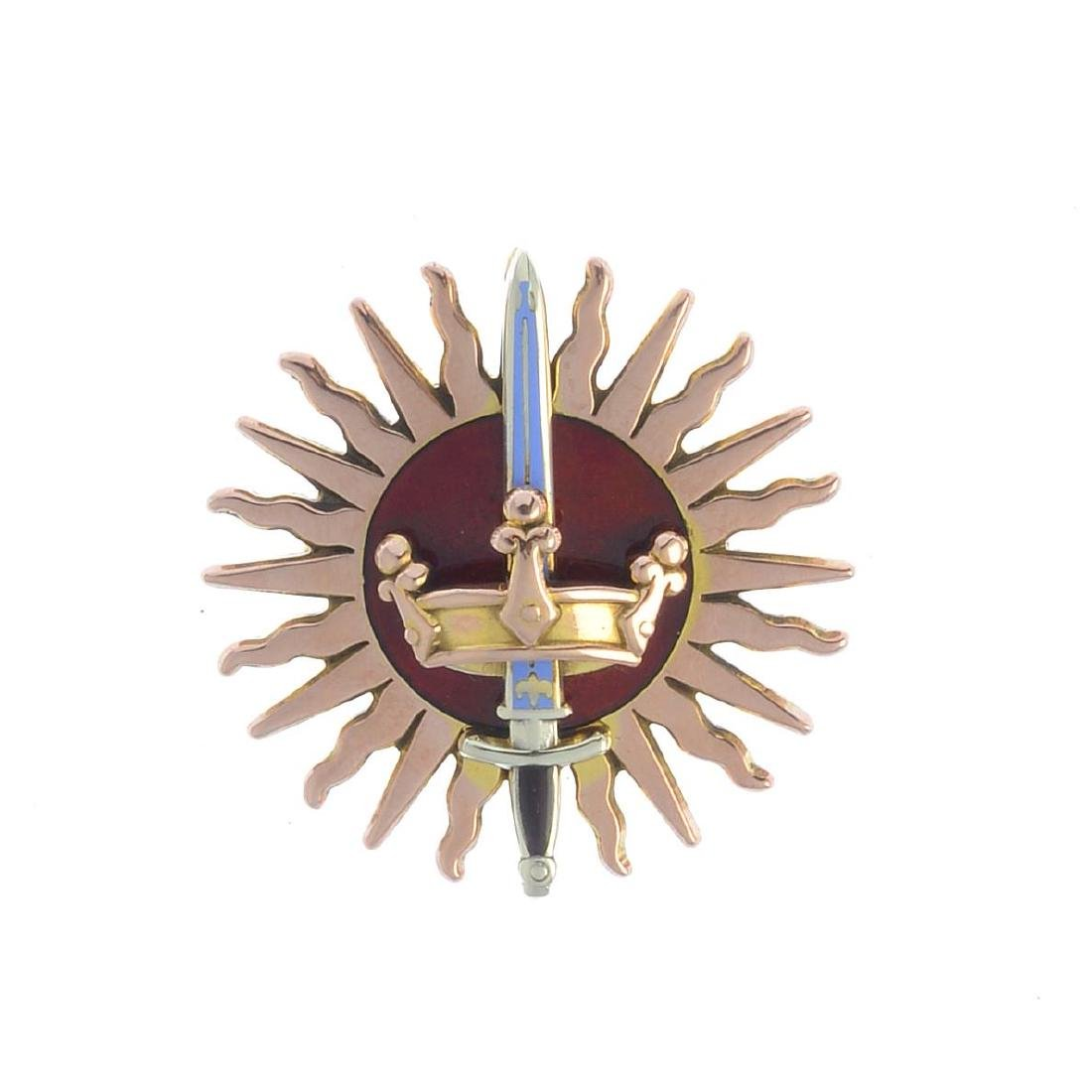 A 9ct gold diamond and enamel brooch. Designed as a